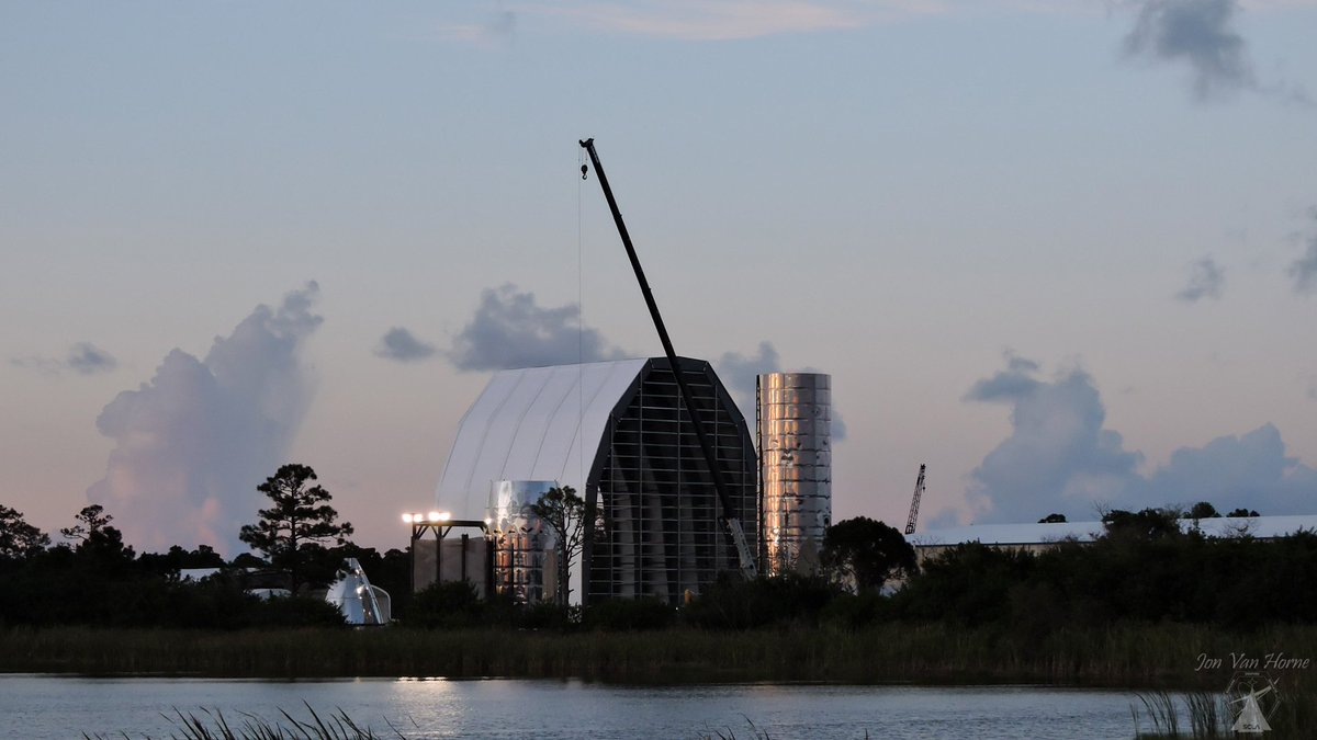 Lots of clickity clanging during dusk at #SpaceCoastStarship nothing really visual of work, but definitely activity going on again. Top section of nose cone still removed, and some added material on back (bottom) of the stern (tall vessel) #StarshipEast #Starship 🤠📷🚀