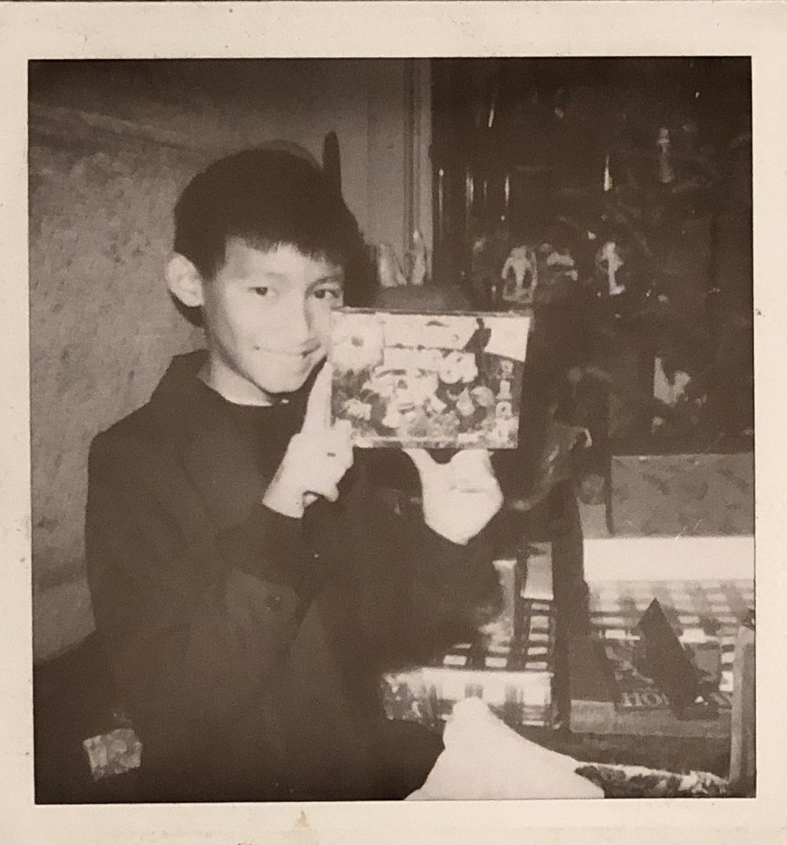 here is a b&w polaroid of me on the christmas that i got Donkey Kong 64