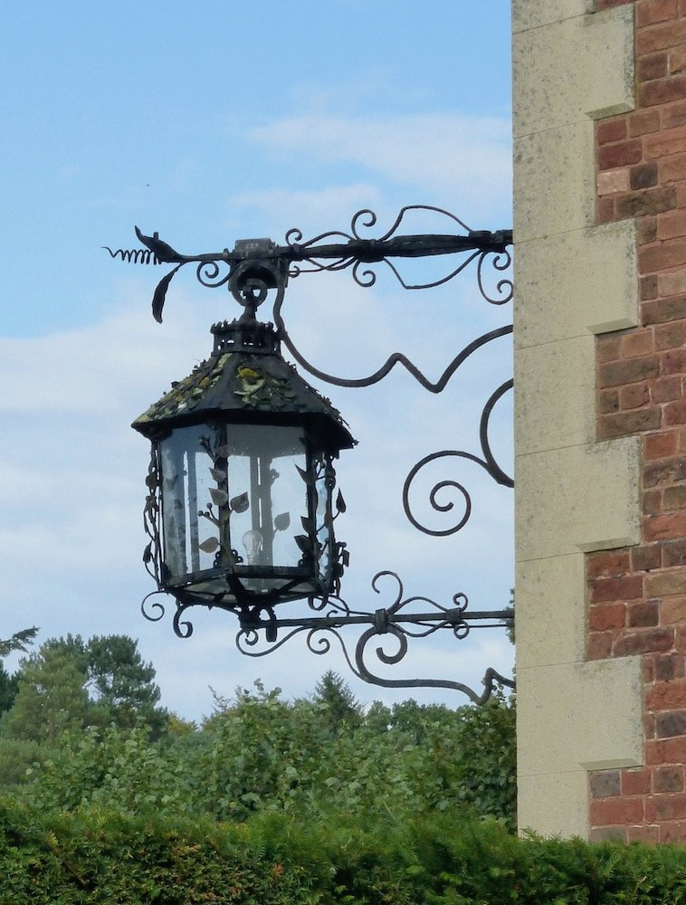#ironworkthursday A joy to come across unexpectedly, this fanciful external lamp at Sandringham, possibly executed by Barnard, Bishop & Barnard of Norwich http://www.victorianweb.org/art/architecture/humbert/2.html …