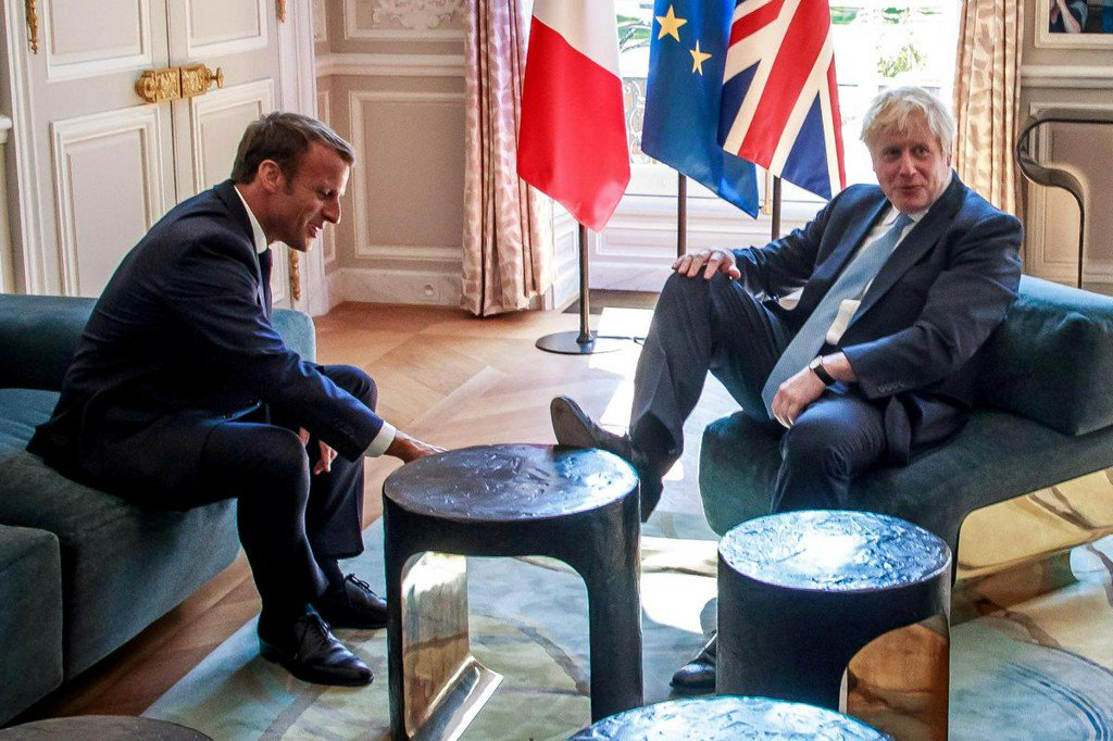 Boris Johnson puts his feet up in Macron's palace https://reut.rs/2zhic05