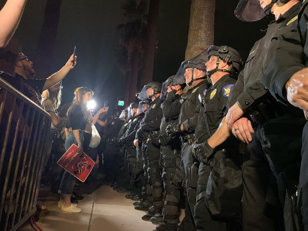 """*UPDATE*  On 7/12/19 at the #LightsForLiberty protest in Phx, 16 people were arrested  Among those taken into custody was Jamaar Williams, who was violently grabbed and arrested that night, """"assaulting a police officer"""" being one of the charges  Thing is, it was all recorded 1/2<br>http://pic.twitter.com/avgrBuVj59"""