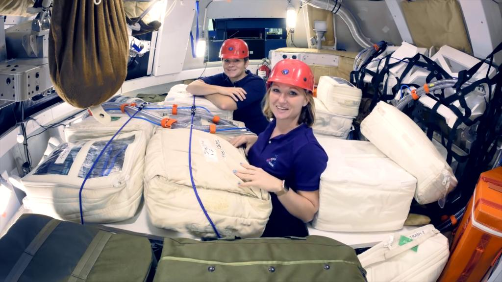 As we prepare for #Artemis missions to send humans to the Moon, Jessica Vos is evaluating how to protect astronauts from radiation in space. In this image, Vos & @AstroAnnimal demonstrate the radiation protection plan in a representative Orion spacecraft: https://go.nasa.gov/2ONokbc