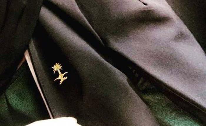 #وزارة_التجارة تلاحق من يروج لـ «عباءة السيفين والنخلة» أو لمنتجات تحمل شعار الدولة، وتتوعد بإحالتهم إلى #النيابة_العامة.•#السعودية #التجارة