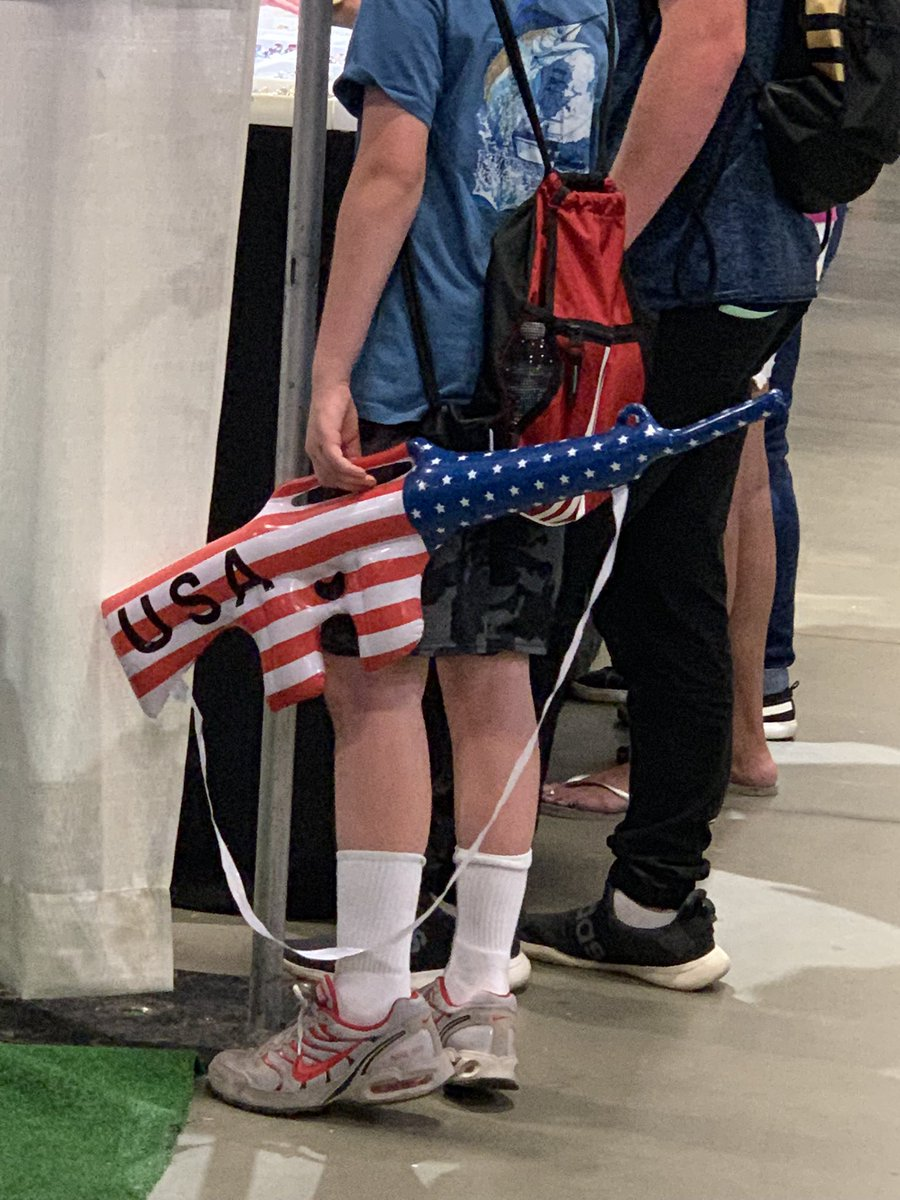 After days of seeing nobody coming over to their booth at the N.C. Mountain State Fair in Asheville, the Republicans began giving inflatable assault rifles away to kids. @BetteMidler @Alyssa_Milano @kathygriffin