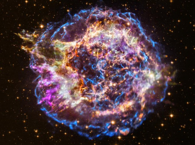expanding bright colored gases in deep space