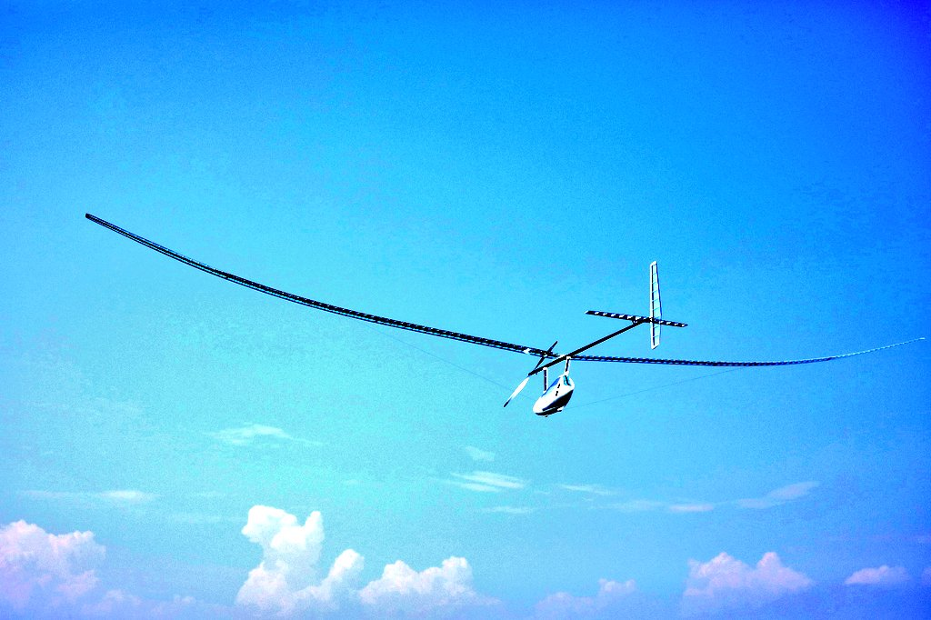 Photo of flying human-powered aircraft over Lake Biwa. Link to the official twitter.