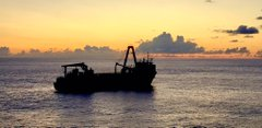 An apparently abandoned Merchant Vessel lies deserted in the Atlantic.