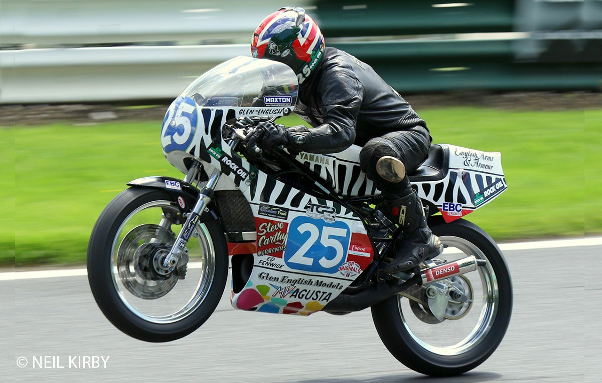 Here's Glen English standing his Sanvenero styled TZ350 on it's stripy hindquarters – just for #wheeliewednesday. @CadwellPark must surely be the wheelie capital of the UK, what do you think? #postclassic #TZ350