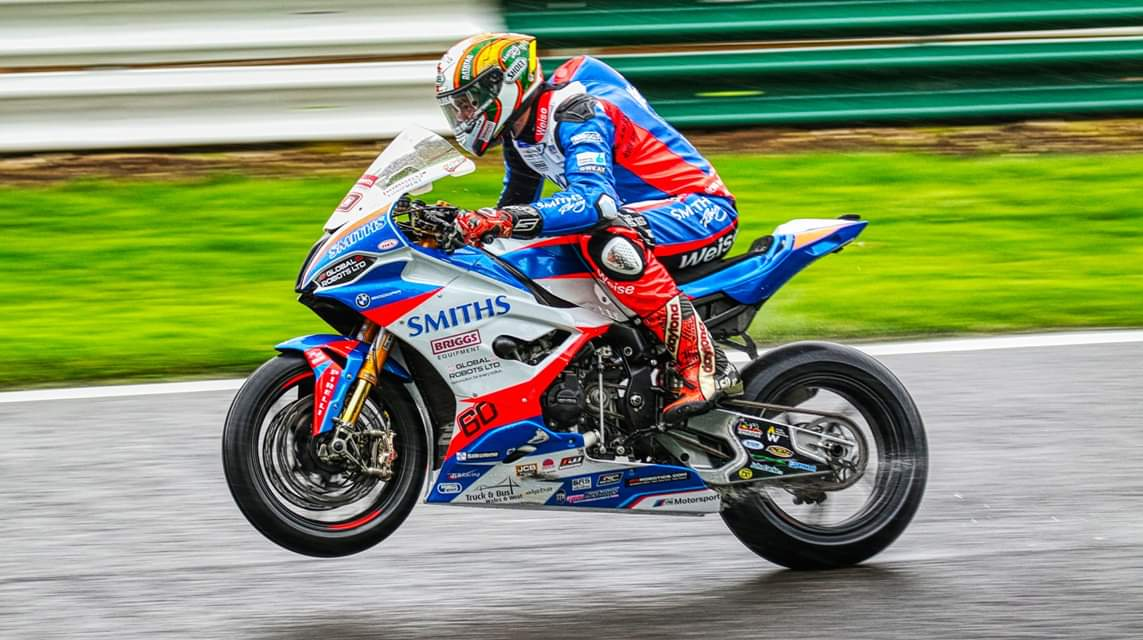 Its #WheelieWednesday heres one of @peterhickman60 aboard the @Smiths_Racing BMW at @CadwellPark 💪🏻🏁