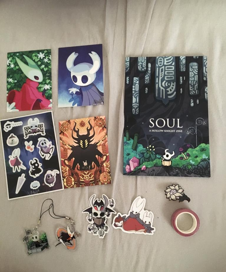 @SoulZine I just received all of this in the mail!!!!! Thank you to every member of the zine and artists to bring such an amazing love letter to hollow knight with those amazing illustrations and quality items           💜💚💙🐞🐝🐛🦗❤️🧡💛
