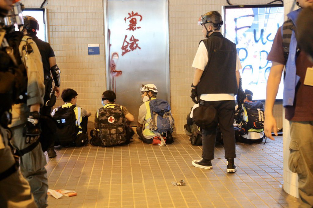 """Volunteer medics' hands got tied with cable tie by #hkpolice. Police: """"these cockroaches pretend to be medics."""" Medic asked did police see them as criminals. Police replied """"You are, motherf**ker! Nobody needs your help!"""" #hkpoliceisterrorist #HKPoliceState Photo: @inmediahk"""