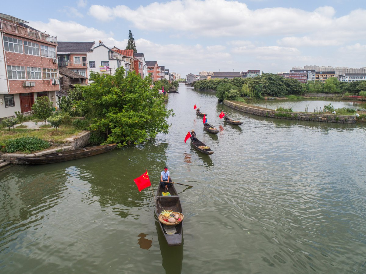 It's the season to go with the flow: A boat parade displaying the bounty of this year's harvest in Tangqi, Zhejiang, east China