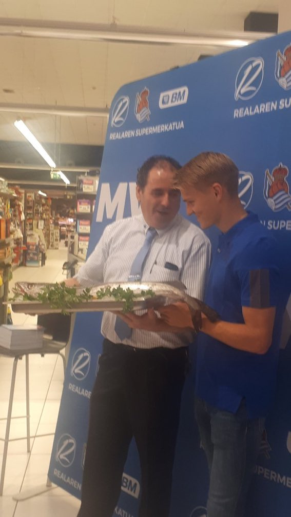 🐟😅 Martin Ødegaard has won Real Sociedads player of the month award It appears that hes been given a large fish in a supermarket as his award