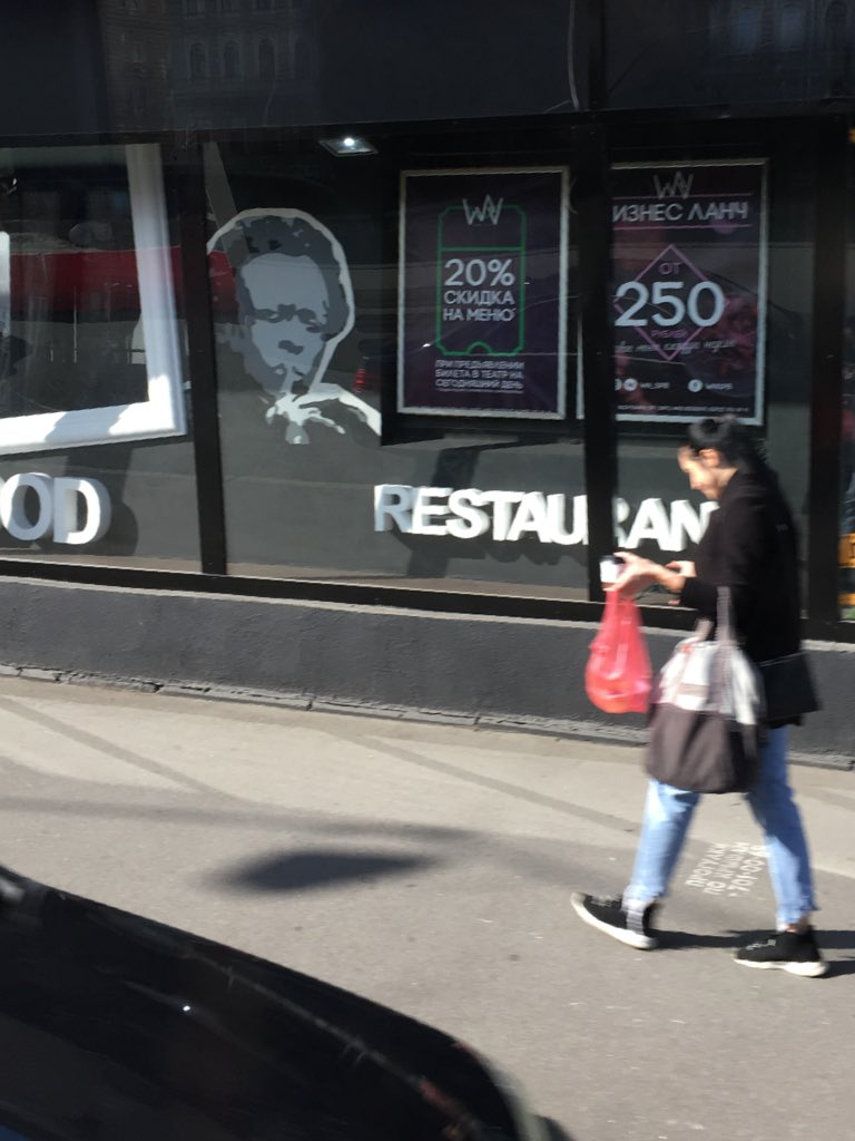 World-wide impact: Image of jazz great Miles Davis of Alton and East St. Louis can be seen in the window of a restaurant in St Petersburg, Russia.