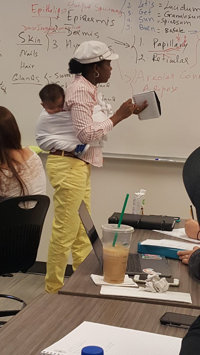 Georgia Professor Holds Student's Baby, A Life Lesson Bundled On Her Back