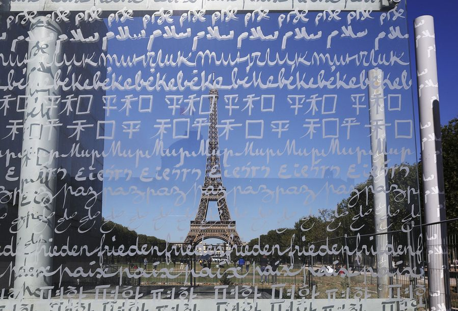 """Check out the Wall for Peace beside France's iconic Eiffel Tower in Paris. The word """"PEACE"""" is engraved on it in 32 languages"""