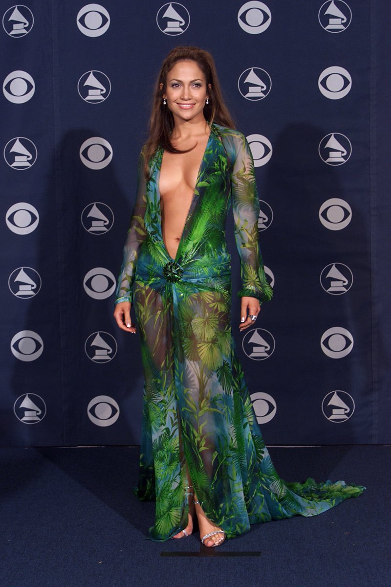 JLo just walked for Versace S/S 2020 wearing another jungle print dress. Nearly 20 years after she wore it at the Grammy Awards #MFW