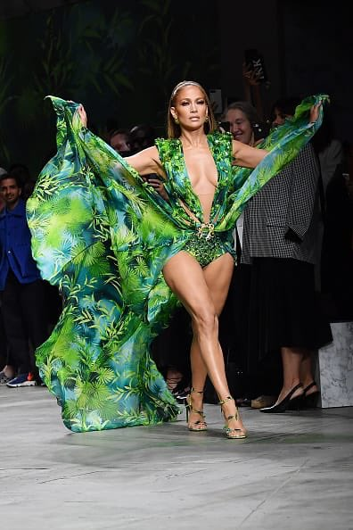 WE HAVE NO WORDS  Almost 20 years apart. Jlo has never looked better. Have we teleported to to the 2000s? #Jlo just shut down #MFW at @versace  #grammys <br>http://pic.twitter.com/5E4M9aXOVs