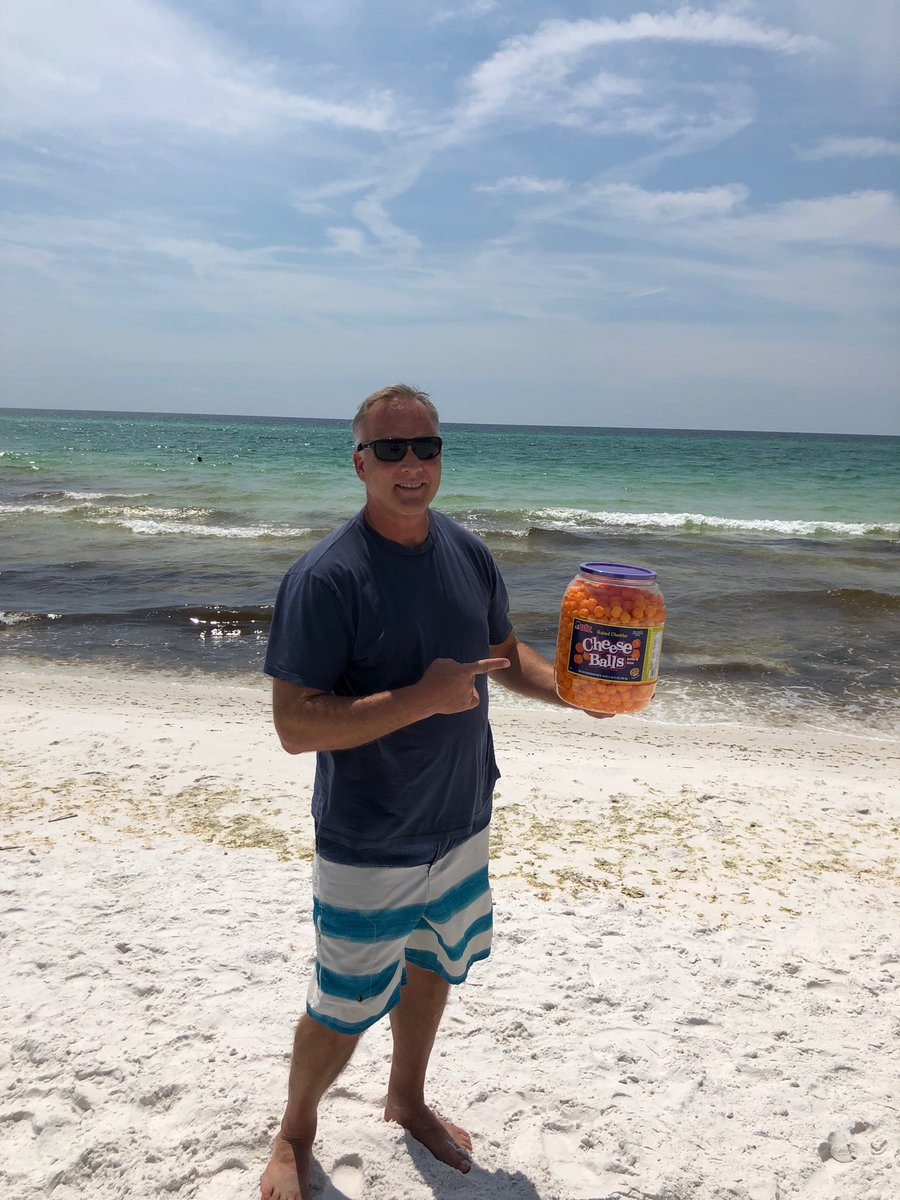 Here's Mark Richt enjoying retirement on a beach with a bucket of cheese balls
