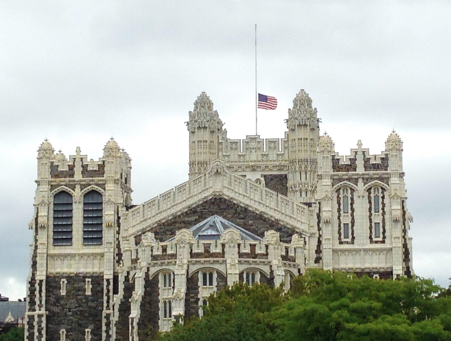American flag at half mast above CCNY Shepard Hall