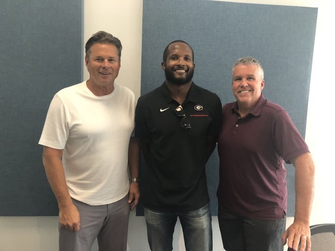 Buck Belue (left) with Champ Bailey (middle) and co-host John Kincade (right) from 680TheFan - (Photo courtesy of Buck Belue, Twitter)