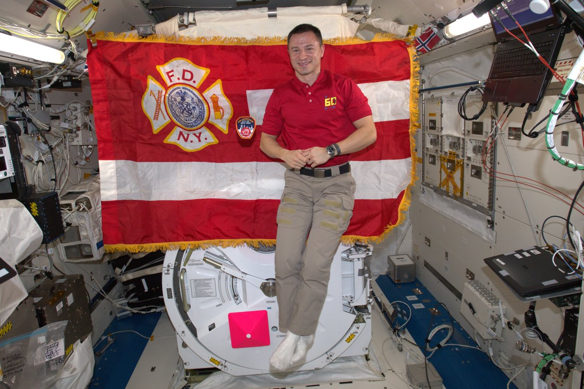 Honoring the brave public servants of @FDNY. Thank you for your service, we remember your fallen comrades. Your flag and patch are proudly orbiting the Earth on board the @Space_Station! #NeverForget