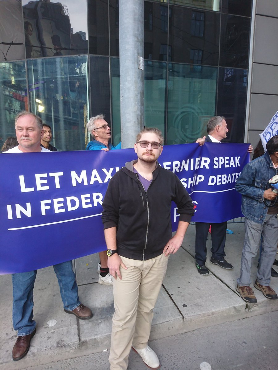 Out on Dundas Square, protesting the suppression of our democracy with fellow citizens passionate about the future of Canada #LetMaxSpeak #PPC2019<br>http://pic.twitter.com/h2DkGXMF0w