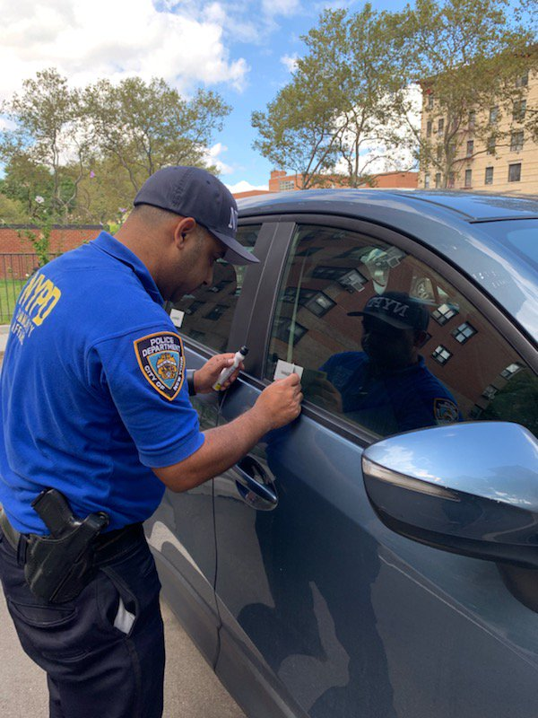 Crime Prevention Officer Matos is making the rounds today etching VIN numbers into car windows to combat auto theft. Make an appointment today at (212) 860-8108. #VINetching in #EastHarlem.
