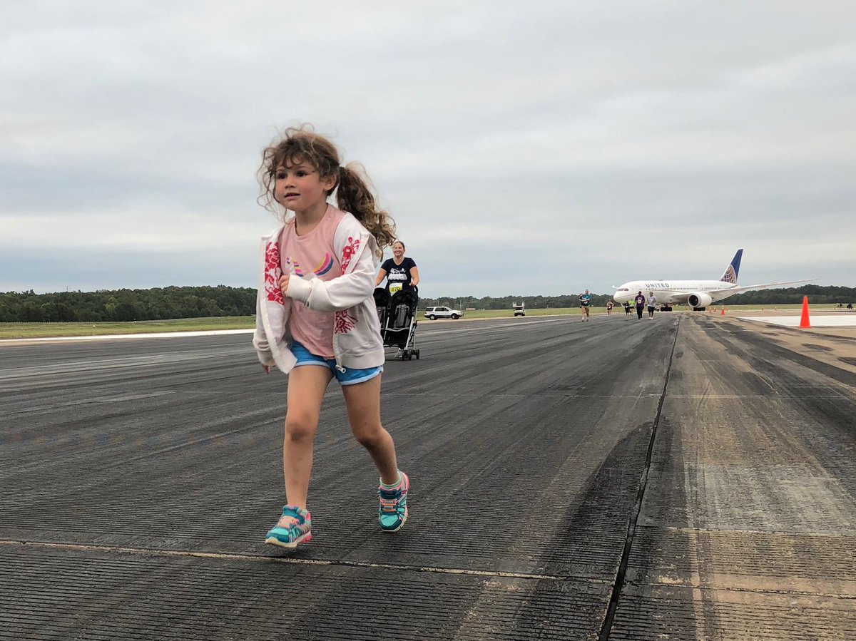 This little one is racing past mile 1, as part of a5/10k run on Dulles International Airport's runway. It's the kick off to a day of fun for the public at the Dulles Plane Pull Festival!@wusa9  #getupdc  #dullesday