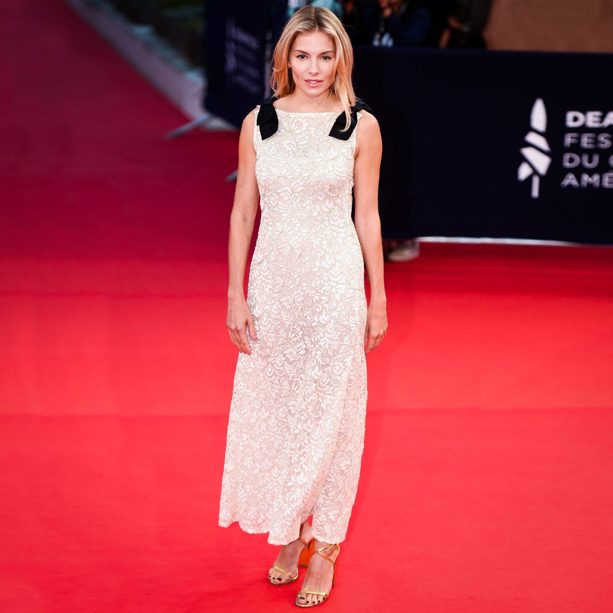 Actress Sienna Miller wore a white and gold lace dress from the #CHANELCruise 2019/20 collection for the premiere of 'American Woman' at #Deauville2019.#CHANELinCinema