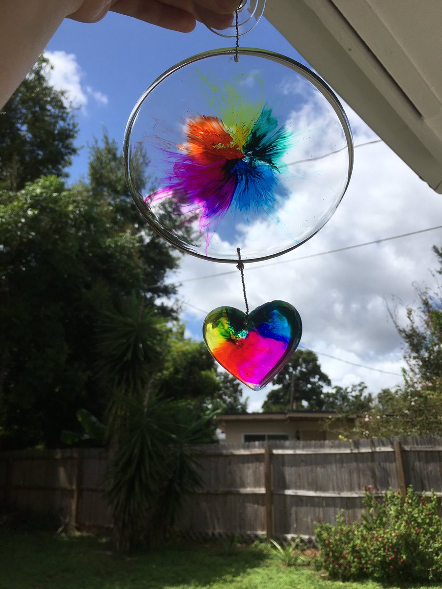Made this rainbow disc into a suncatcher! It's so pretty!!! It's imperfect (a hardly visible tiny scratch or two), it's for sale, $25 if anyone wants it! disc is 5 inches. :) #rainbow #suncatcher #resin #resinart #rainbowdecor #heart #orlandostrong #orlando #orlandoartist