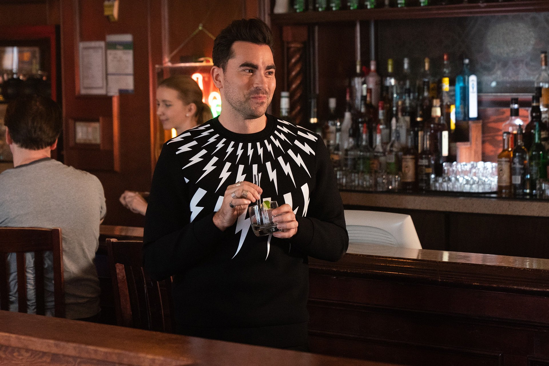 David at a bar in his sweater emblazoned with lightning bolts