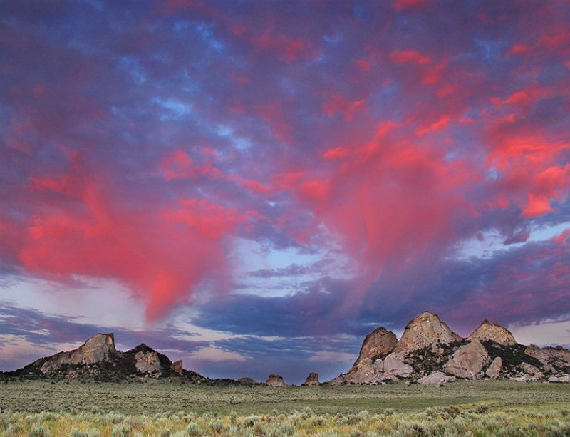 Cotton candy clouds dance over the rugged landscape at City of Rocks National Reserve #Idaho #FindYourPark<br>http://pic.twitter.com/9B8Cotg4fq