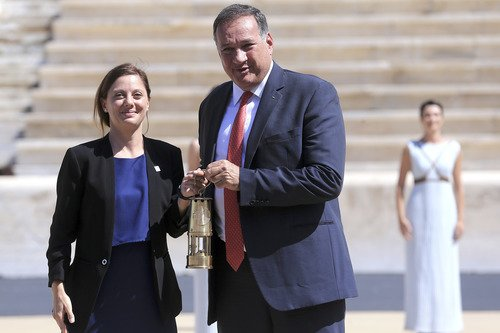 The Flame burning for the Lausanne 2020 Winter Youth Olympic Games is lit and handed over to organizers in the Panathenaic stadium in Athens, Greece