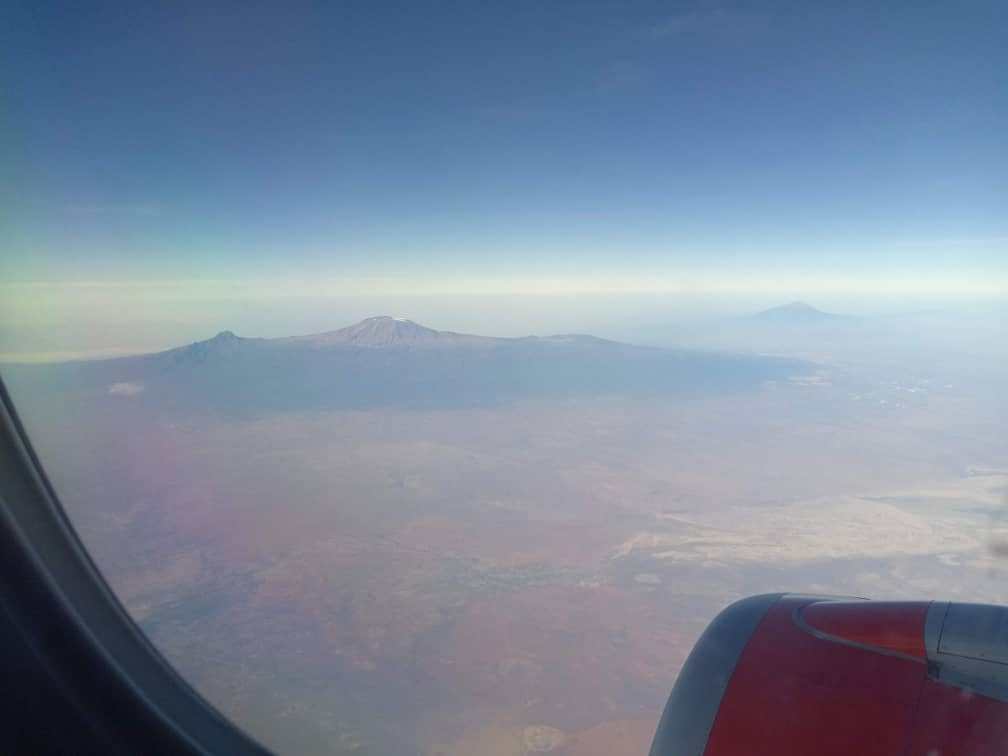 As much as this is breathtaking its also worrying for any climate change observers - the reducing snow cover on Mount Kilimanjaro. This should worry us all! I took this picture today at 32,000ft, in the background on the right is Mt Meru. #BreathtakingAfrica #VisitEastAfrica
