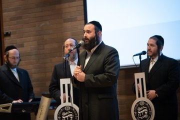 A group of Jewish men perform a song.