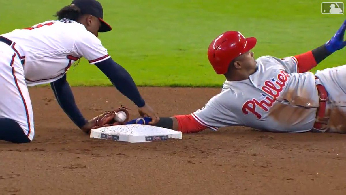 Ozzie Albies pushes Jean Segura hand off base