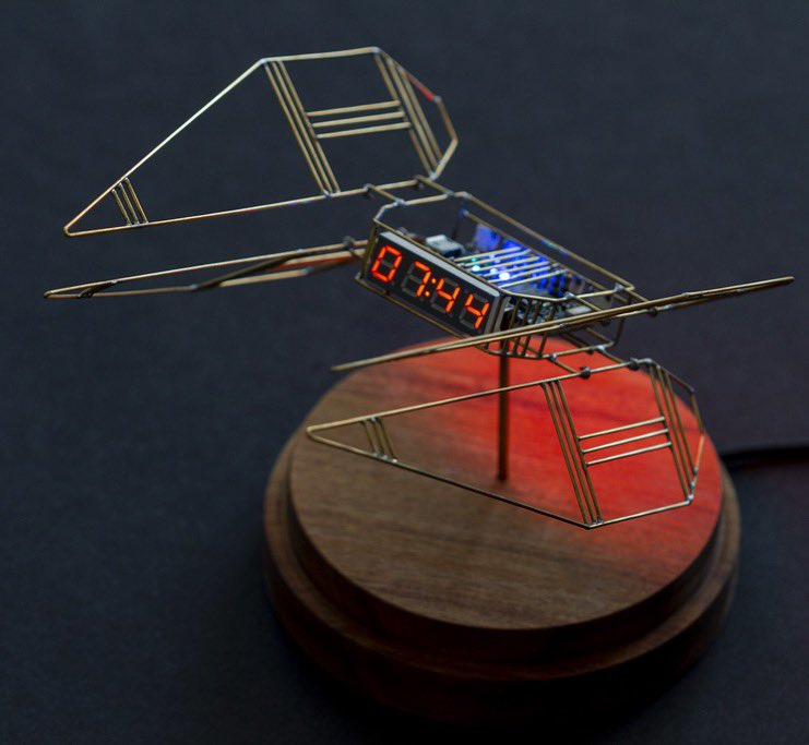 A second addition to the spaceship series of bedside clocks. This one derives inspiration from the Star Wars Tie Interceptor and Art Deco.