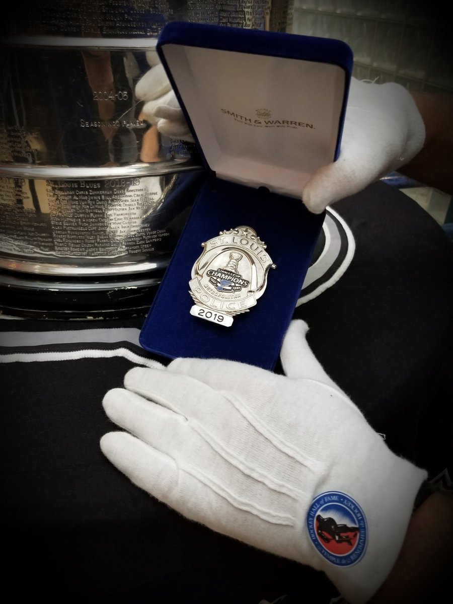 A special day in St Louis for the @HockeyHallFame The @SLMPD donated one of their limited edition #StanleyCup @StLouisBlues badges for display. Thank you, also thanks for hanging out all summer with us. @NHL