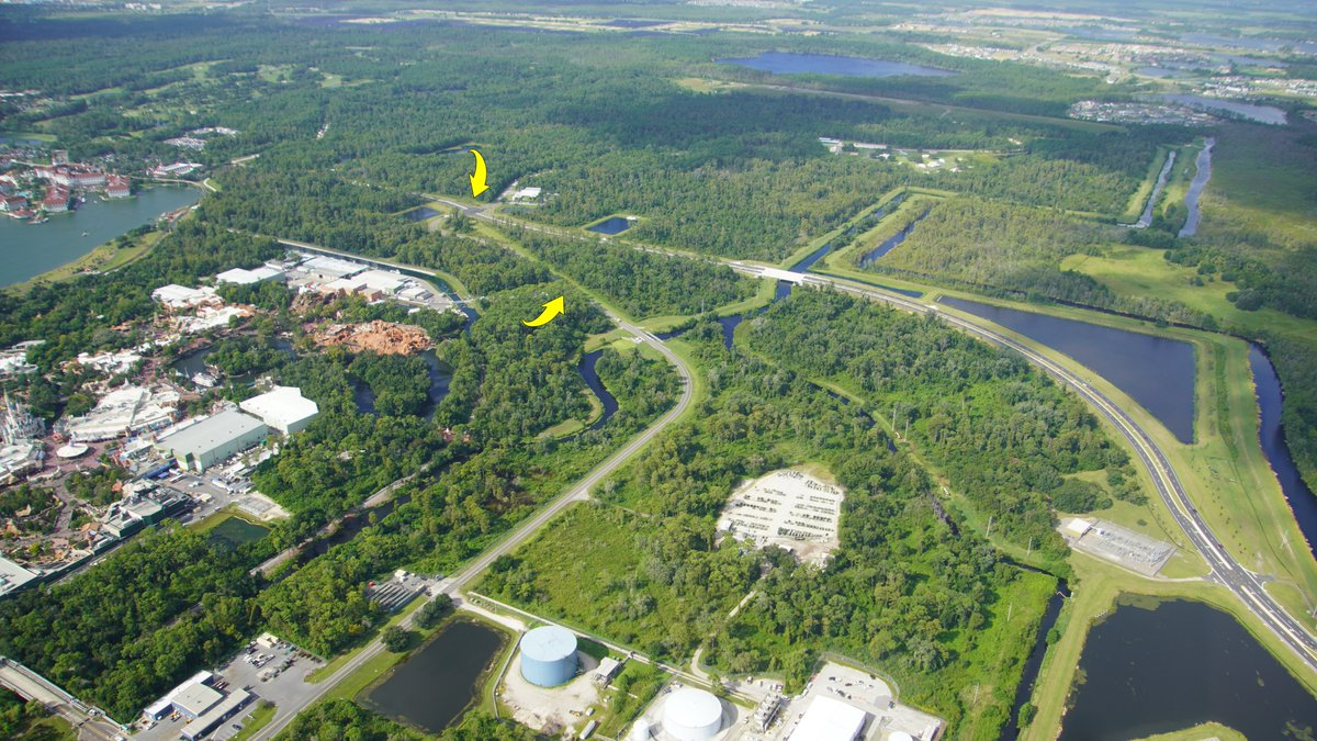 Aerial view of where many runDisney courses have left Magic Kingdom (center arrow) to continue South. Courses now will pass through an intersection with Floridian Place. A new road seen at right that intersects with Reams Rd. <br>http://pic.twitter.com/8bsIjBw6H4