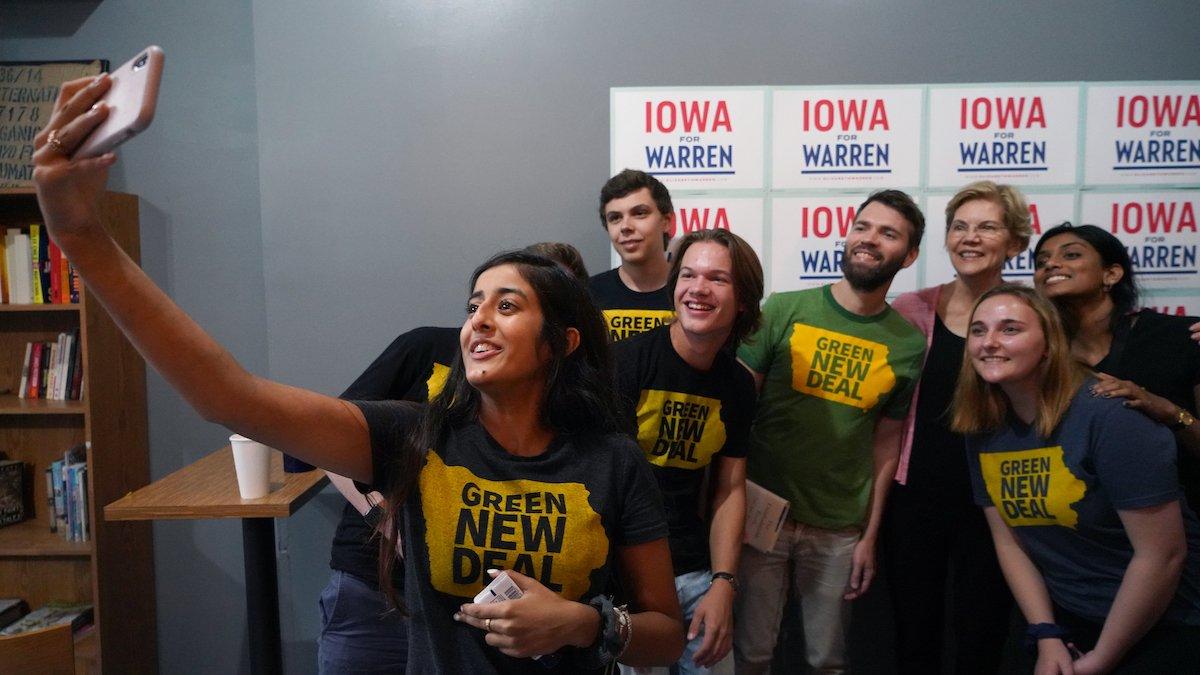 Elizabeth Warren takes a selfie with climate activists in Cedar Rapids.
