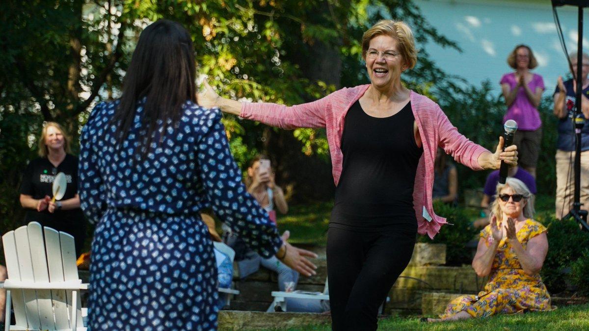 Elizabeth Warren runs to hug a supporter in Mount Vernon, Iowa.