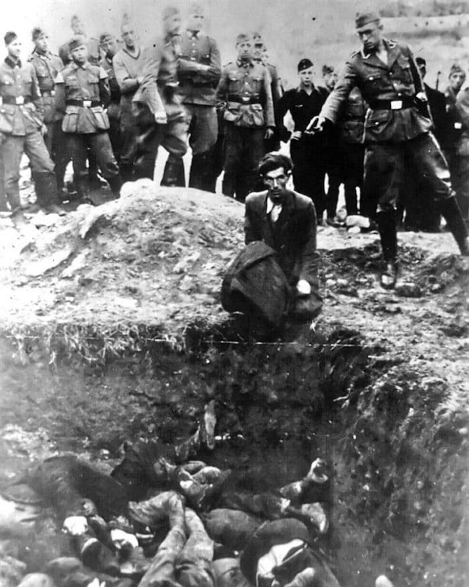 "German & Ukrainian SS men pause in their massacre to snap a souvenir photo, captioned ""The Last Jew in Vinnitsa""."