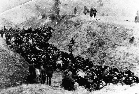 Outside Vinnytsia, Ukraine, Nazi SS men have forced 28,000 Jewish inhabitants to assemble along newly-dug ditches outside the city.