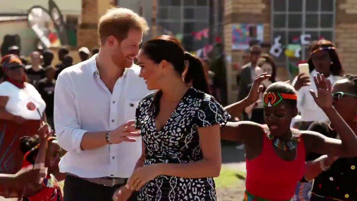 Prince Harry and Duchess of Sussex Meghan Markle visit Nyanga Township in Capetown where an initiative teaches children about their rights and join in on some dancing.