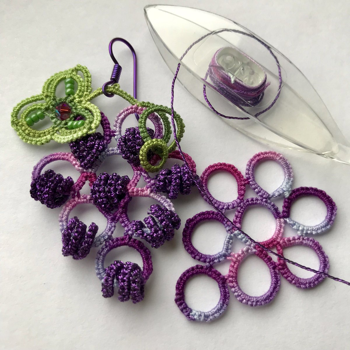 Working on grape earrings from a pattern in an Italian magazine, IL MIO Chiacchierino Oct/Nov2014. #tatting #chiacchierino #grapeearrings #tattingearrings