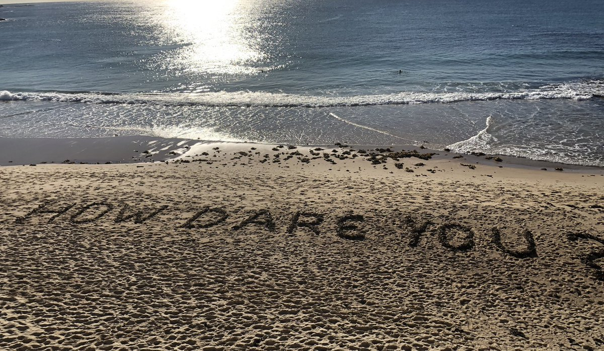 #howdareyou A homage to #Greta created on #coogee beach this morning by a semi retired electrician. He's in awe, he'd given up but he has hope again after seeing her speech. pic.twitter.com/UahYoS0q4u