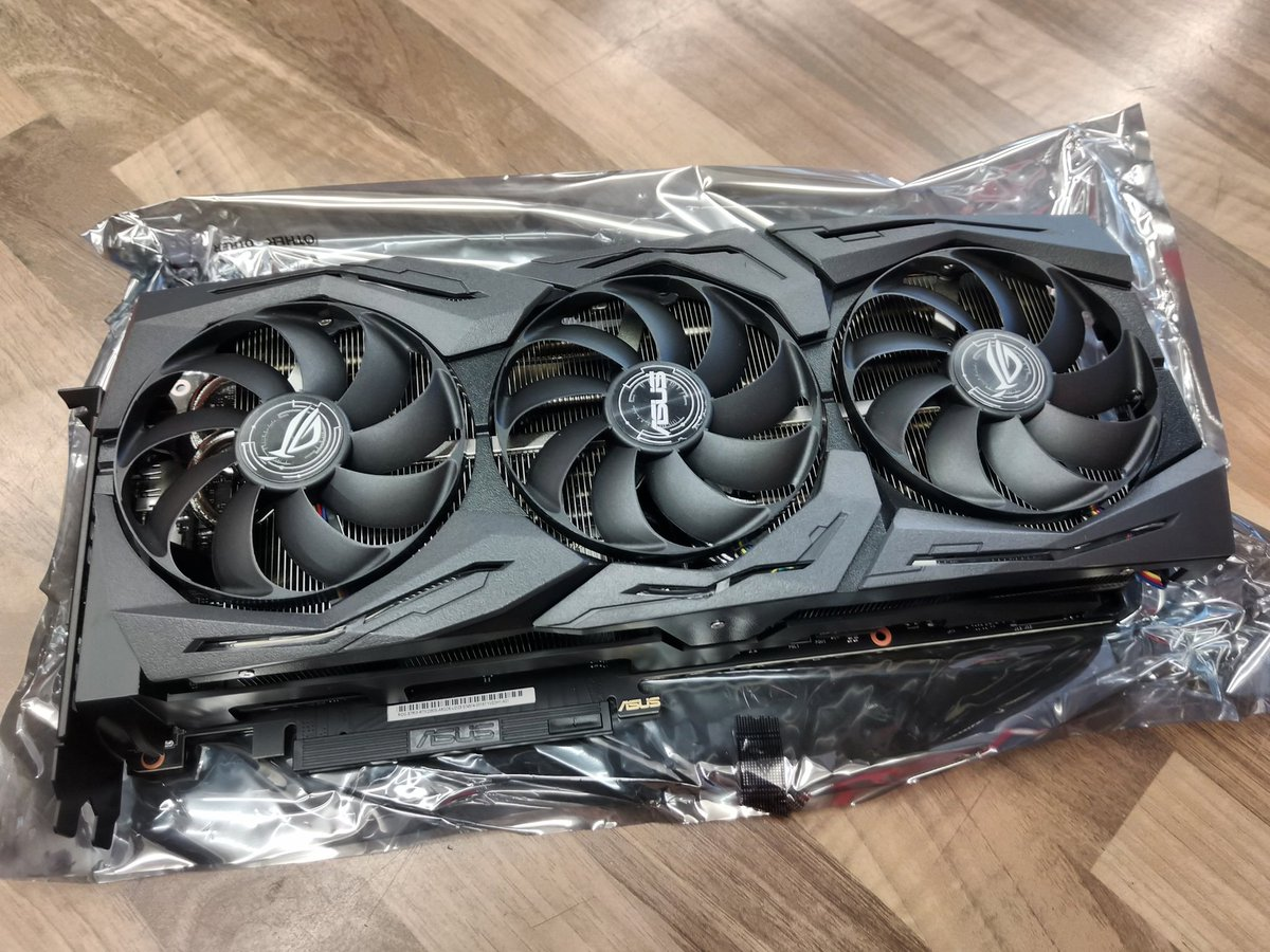 Installing an RTX 2080 Super for a customer and this thing is a monster (hand in second shot for size)  Let's get this wired up and gaming #nvidia #nvidiartx #nvidiartx2080 #rtx2080ti #rtx2080super #newportsouthwales #newport #iconcomputing #customcomputers #customgaming pic.twitter.com/RTx6ICOI2j