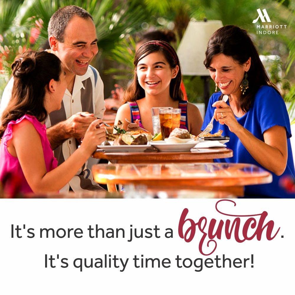 family eating at restaurant - 900×450