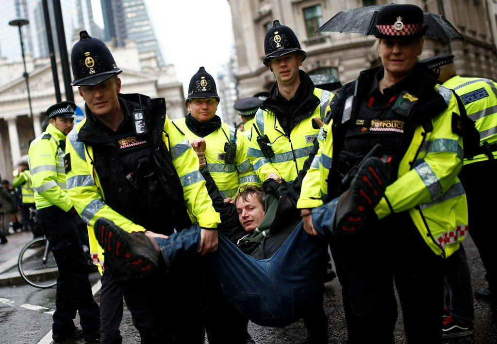 Climate change activists target London's financial district